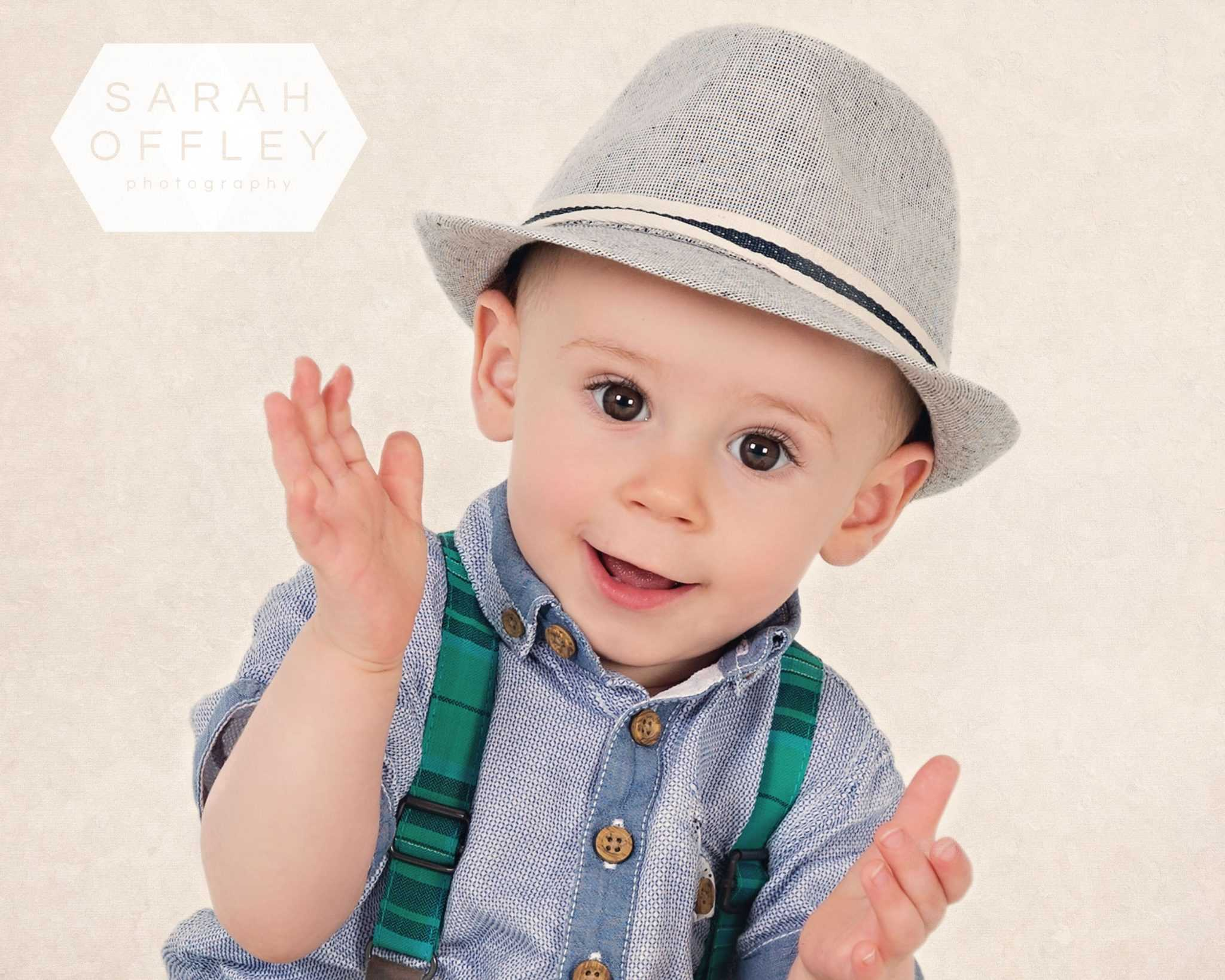 baby in fedora hat birthday session wirral