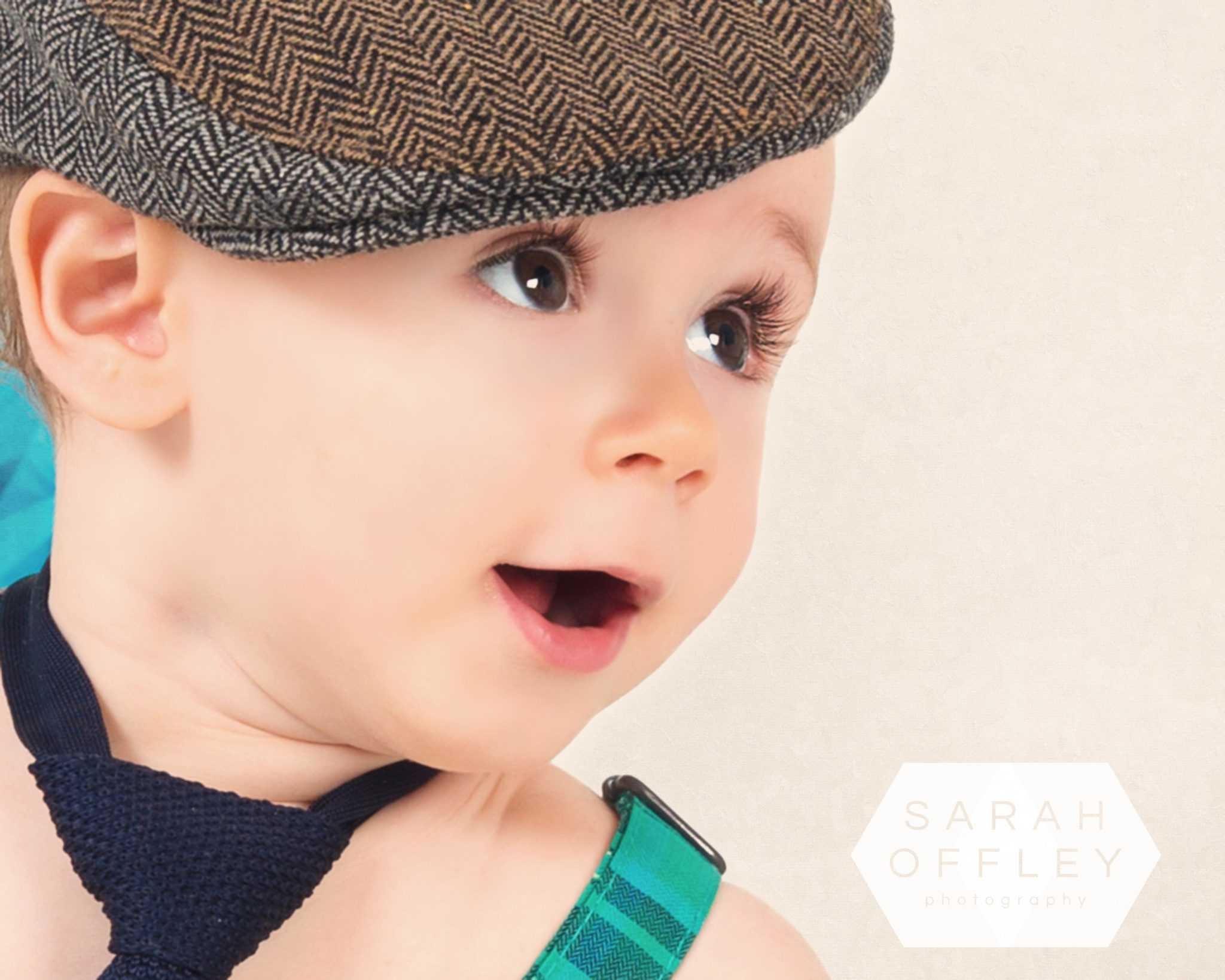 baby in flat cap birthday photoshoot