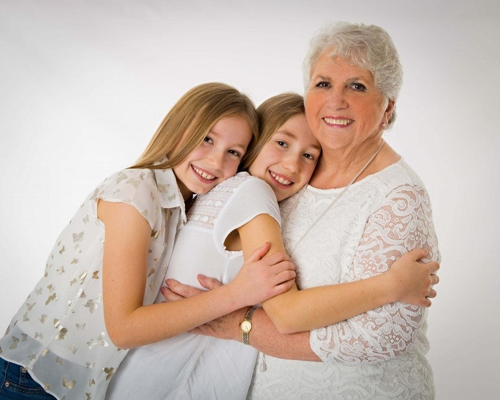 grandmother and granddaughters family cuddle photograph