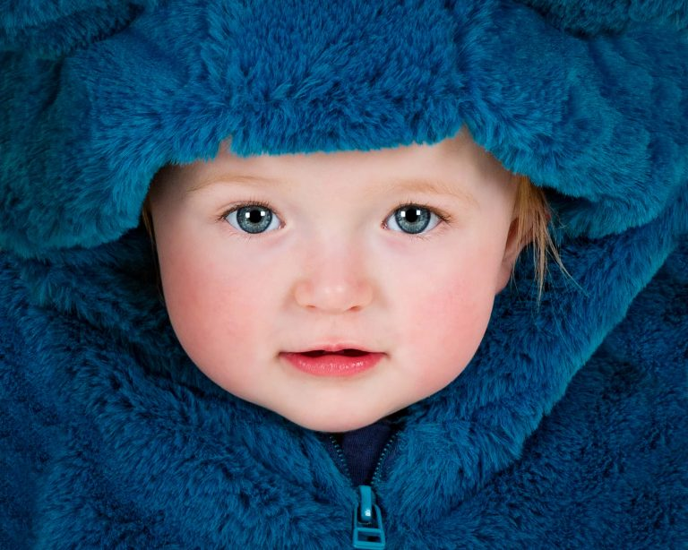 stunning close of of baby in fur hat