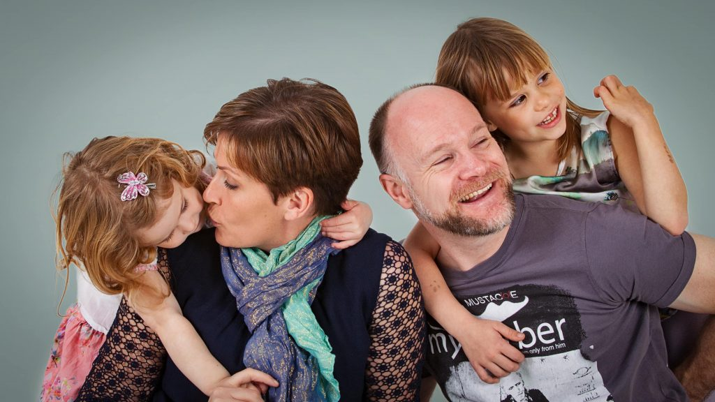 mum and dad with daughters colourful family photography