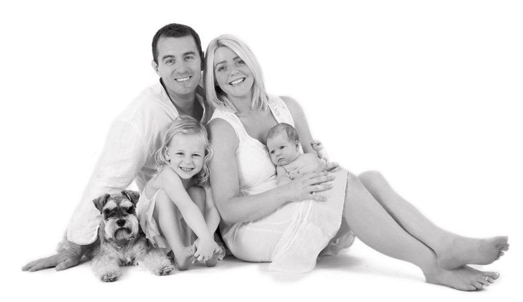 newborn family with dog portrait