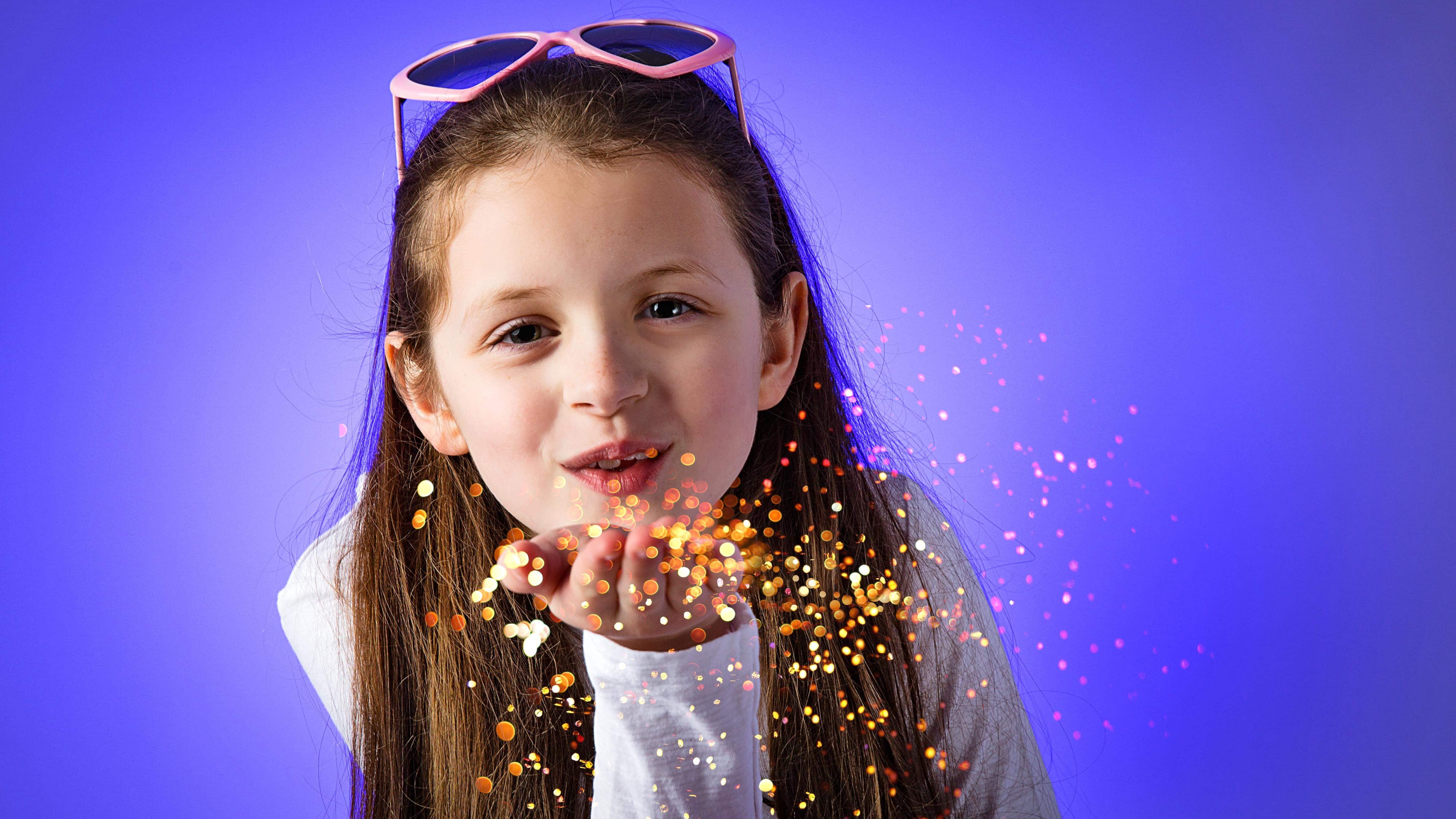 girl blowing glitter photo shoot Sarah Offley Ellesmere Port