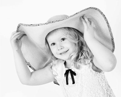 girl with large hat on portrait photo Sarah Offley